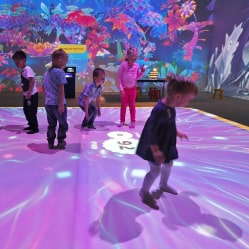 Kids playing on an interactive floor